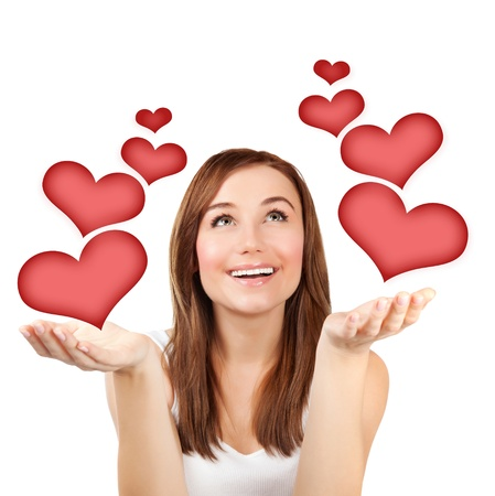 Picture of pretty woman with red hearts isolated on white background, female in love, first affection, Valentine day, romantic teenager girl, closeup portrait of dreamy young lady, love concept  photo