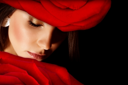 Image of glamorous woman wearing stylish floral hat, closeup portrait of beautiful arabic female with red rose on head isolated on black background, closed eyes, Valentine day, beauty salon photo