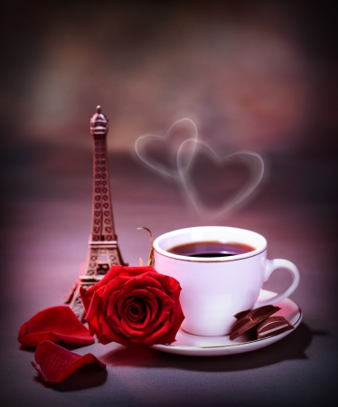 valentine day cup of coffee: Picture of white cup with coffee and chocolate decorated with red rose on the table in Paris, romantic honeymoon, celebration anniversary in France, Valentine day holiday, love and romance concept