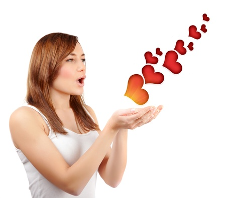 girl blowing: Picture of beautiful woman blowing red hearts isolated on white background, cute female send romantic kiss, Cupid girl, Valentines day, sweet holiday, romance and love concept