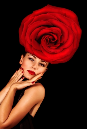 Image of stylish young lady with big red rose on the head isolated on black background, fashionable model wearing glamorous floral hat, Valentine day, luxury lifestyle, vogue and style concept Stock Photo - 17792517