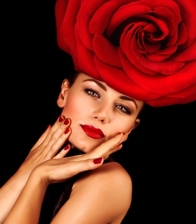 Photo of sensual woman with fashionable hairstyle isolated on black background, luxury beauty salon, girl wearing floral hat with red rose, perfect makeup, Valentine day, passion and seduction concept