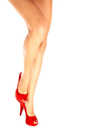 feet naked: Picture of beautiful female legs in red shoes on high heels isolated on white background