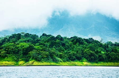 Image of Costa Rica, nature of Central America, fog in the mountains, green forest near river, beautiful landscape, eco tourism, panoramic scene, peaceful nature, travel and vacation concept photo