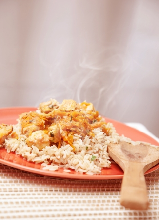chicken rice: Photo of hot chicken meal with rice, traditional chinese cereal with tasty prepared fish, healthy nutrition, organic food, dinner in restaurant, plate with spicy dish on the kitchen at home Stock Photo