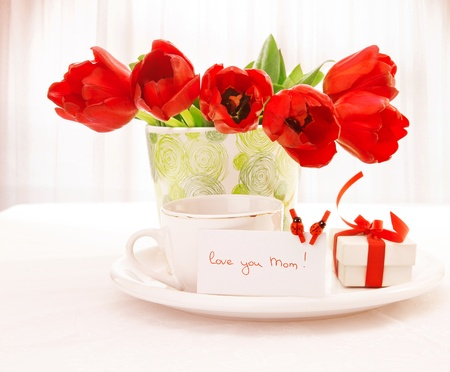 flower box: fresh red tulip flowers in beautiful vase on table