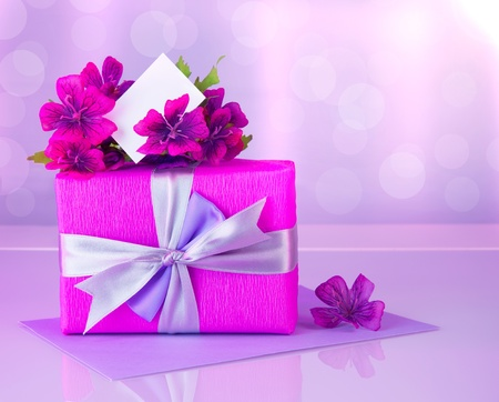 giftbox: Picture of pink gift box with purple silk ribbon