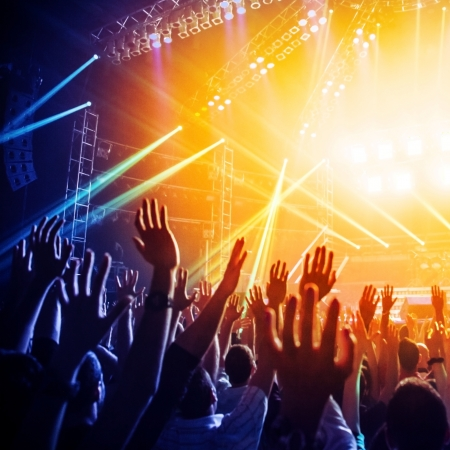 Photo of many people enjoying rock concert, crowd with raised up hands dancing in nightclub, audience applauding to musician band, night entertainment, music festival, happy youth, luxury party  photo