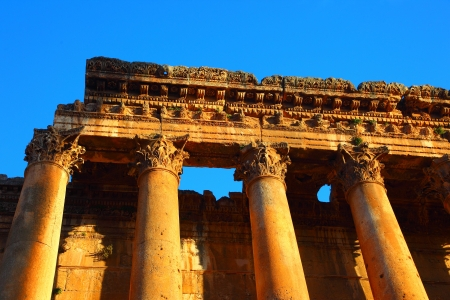 heliopolis: Picture of Baalbeck temple ruins in Heliopolis over clean blue sky background, arabian architecture, Jupiter columns, famous landmark in Lebanon, religious monument, tourism and travel concept