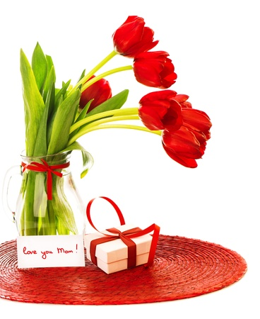 Image of beautiful red tulips bouquet in vase, white gift box with ribbon, greeting card, love you mom, happy mothers day, flowers bunch as present, romantic still life, merry holiday, love concept   photo