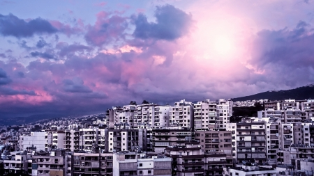 lebanon: Picture of beautiful purple sunset over city, peaceful landscape, architecture in Lebanon, arabian buildings, panorama of downtown, cloudy sky, pink sunrise, travel and tourism concept  Stock Photo