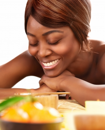 Picture of beautiful afro female with closed eyes lying down on massage table and enjoying dayspa, black young lady relaxed in luxury spa salon, skin care, healthy lifestyle, wellness concept  photo