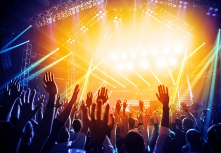 live happy: Photo of young people having fun at rock concert, active lifestyle, fans applauding to famous music band, nightlife, dj on the stage in the club, crowd dancing on dancefloor, night perfomance Stock Photo