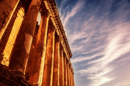 heliopolis: Photo of Baalbek Heliopolis ruins, ancient Lebanon landmark over dark blue sky, arabian architecture, antique religions building, famous jupiter monument, columns statue, retro style image Stock Photo