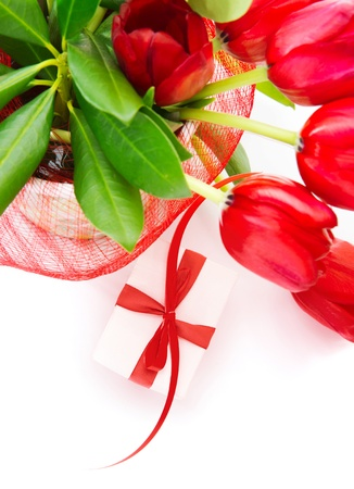 Photo of festive border, red fresh tulips bouquet in the pot, small white gift box with red ribbon, isolated on white background, home decoration, floral bunch for mothers day, romantic holiday photo