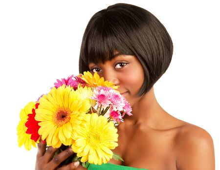 Attractive young black woman holding in hands fresh colorful flowers isolated on white background photo