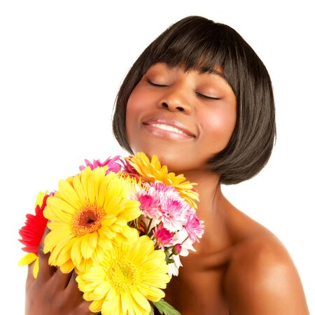 Happy cute black female with closed eyes enjoying beautiful fresh flowers bunch, spring time, isolated on white background photo