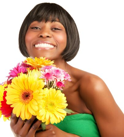Attractive black smiling model holding fresh wildflower bouquet isolated on white background  photo