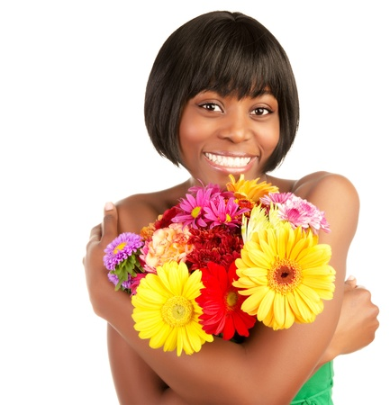 big daisy: Cute smiling african young lady enjoying great fresh colorful flowers bouquet isolated on white background Stock Photo