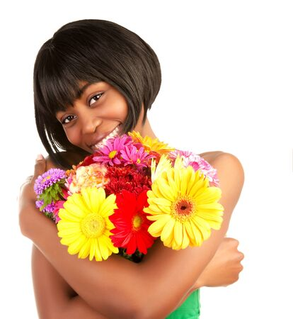 Happy cute black female enjoying romantic fresh flowers bouquet, spring time, isolated on white background photo