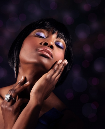 salon background: Closeup portrait of attractive sensual black woman with perfect makeup, luxury beauty salon