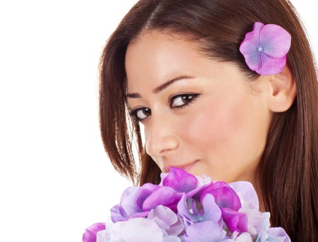 Happy pretty female relaxed in spa salon, closeup portrait of cute seductive girl with fresh purple orchid flowers isolated on white background, beauty concept Stock Photo - 18636052