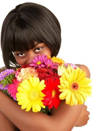 Cheerful black female enjoying sweet flowers smell, cute african girl with great colorful bouquet isolated on white background  photo
