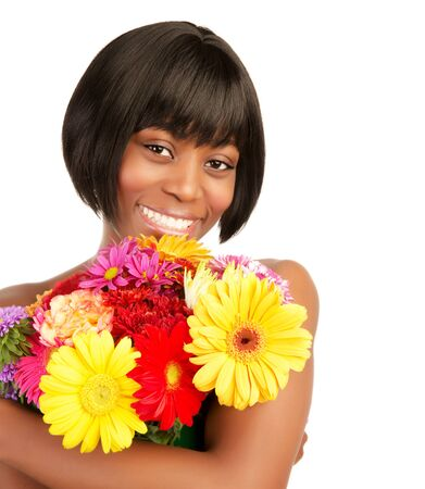 Attractive woman holding in hands beautiful gerbera bouquet isolated on white background, happiness concept photo