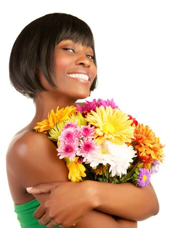 Gorgeous happy American woman holding fresh colorful daisy flowers isolated on white background, spring season photo
