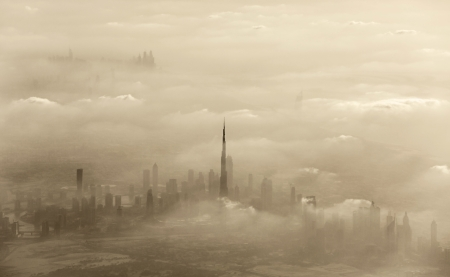 Dramatic sand storm in Dubai, UAE, luxury resort, beautiful city covered with dust, windy weather in desert