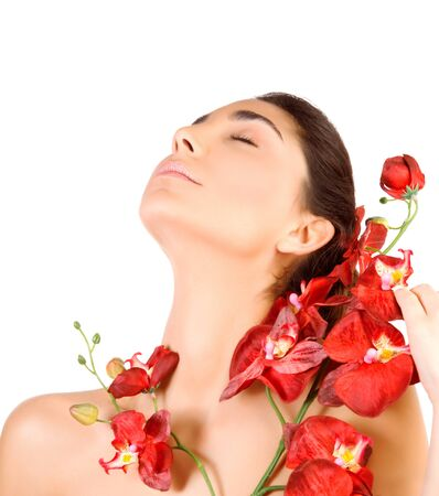 dayspa: Beautiful arabic woman with closed eyes and red orchid flowers isolated on white background, enjoying dayspa, beauty salon