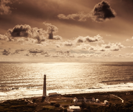 punt: Lighthouse over sunset, beautiful seascape, Kommetjie at Slangkop Punt near Cape Town, nature of South Africa Western Cape Stock Photo