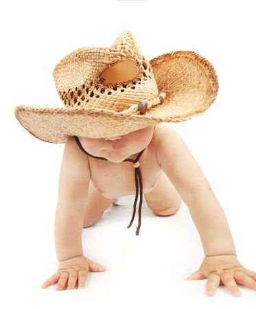 Sweet baby boy wearing big hat and crawl in the studio on white background, happy childhood  photo
