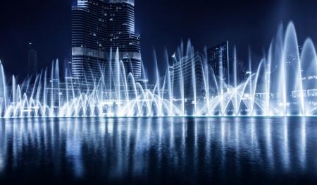 dubai city: Beautiful famous fountain in Dubai at night, romantic music, water dance, blue lights, luxury resort, evening cityscape
