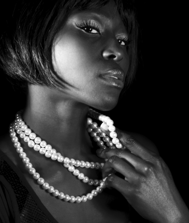 glamours: Black and white attractive African female wearing stylish accessories, perfect makeup, fashionable short hairstyle, luxury beauty salon
