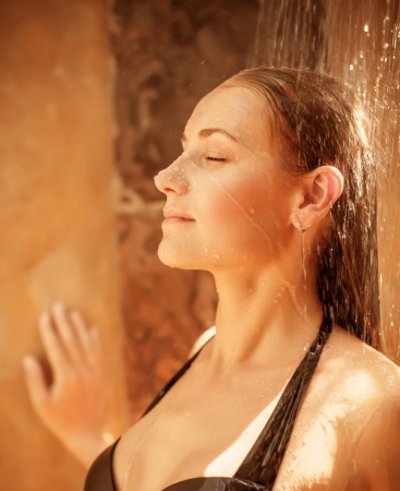 woman bathing: Closeup of beautiful woman take shower outdoors, cute girl with closed eyes enjoying fresh cold water, pampering and hygiene concept