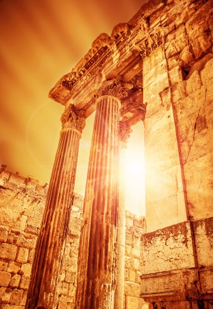 heliopolis: Temple of Jupiter on sunset, ancient historical roman city, Heliopolis ruins, Lebanon Baalbek, old columns architectural landmark, famous religious temple monument, travel and tourism concept Stock Photo