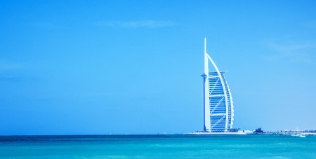 DUBAI, UAE - NOV 21: Burj Al Arab is 321m, second tallest hotel in the world, luxury hotel stands on an artificial island, November 21,2009 Jumeirah beach, Dubai, United Arab Emirates