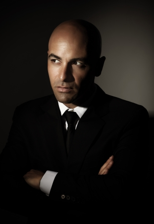 in men's shirt: Portrait of sexy male wearing black suit, white shirt and stylish tie isolated on gray background, luxury lifestyle, business and job concept
