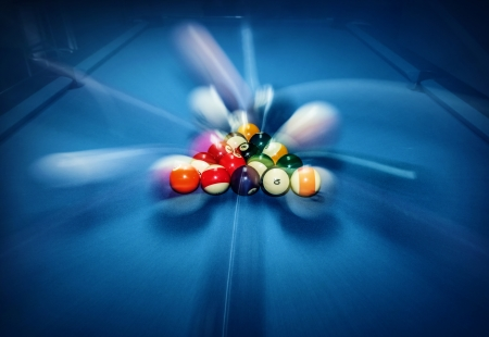 snooker tables: Blue billiard table with colorful balls, beginning of game, slow motion, soft focus, snooker bar, entertainment in nightclub, hobby and sport concept