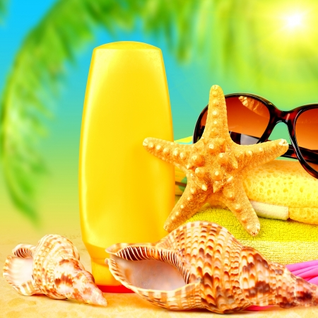 Closeup still life of beach accessories on sea shore, relaxation outdoors at luxury tropical resort, day spa, suntan and sunglasses, summertime holidays photo