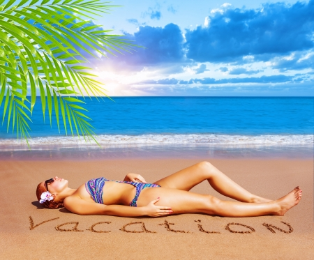 woman laying: Sexy woman laying down on the beach, taking sunbath, enjoying dayspa, luxury tropical resort, summer holiday and vacation concept Stock Photo