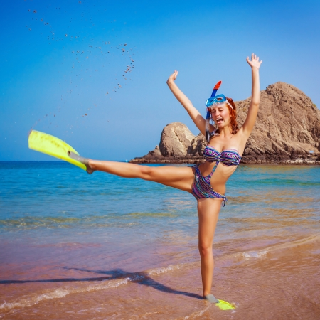 flippers: Happy funny girl wearing diving equipment, raised up hands, tropical resort, active lifestyle, summertime hobby, vacation and tourism concept Stock Photo