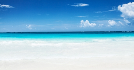panoramic beach: Beautiful seascape, clean turquoise sea, white sandy coastland, blue sky, exotic beach, luxury resort, summer vacation and holiday concept
