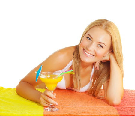 Closeup portrait of cute blond woman drinking fruits cocktail isolated on white background, enjoying alcohol beverage, tropic juice, summer holiday and vacation concept photo