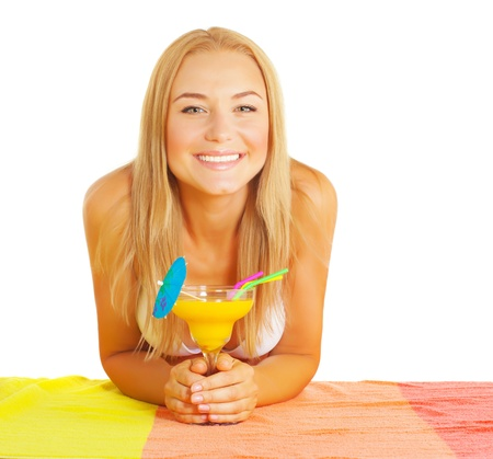 pretty blonde girl: Closeup on happy smiling girl drinking tasty alcoholic beverage with straw and cocktails umbrella isolated on white background, summertime drink
