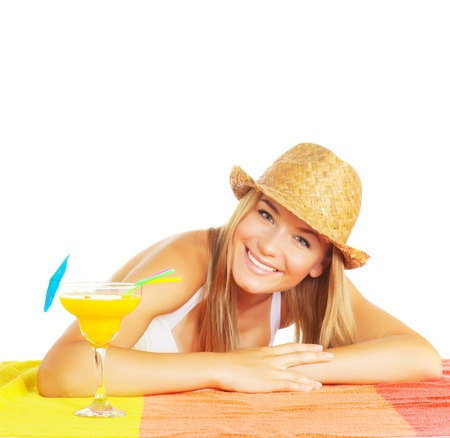 Cheerful female wearing stylish straw hat with fruit cocktail isolated on white background, relaxation in summer time, vacation and holiday concept photo