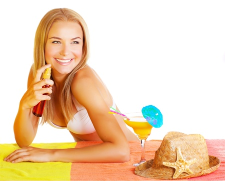 body oil: Beautiful sexy woman using sunscreen isolated on white background, tasty tropical cocktail, straw hat, healthy lifestyle, applying sun protection, summer holidays concept  Stock Photo