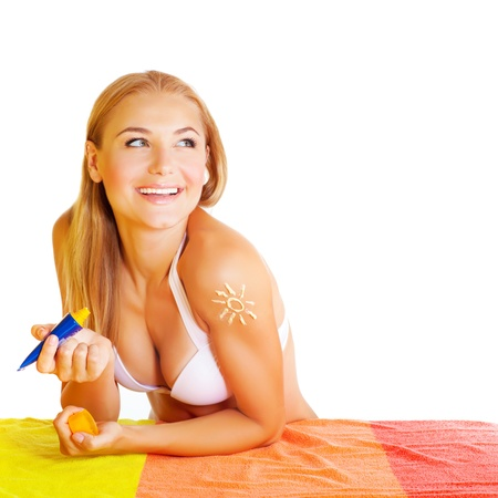 sunblock: Pretty woman applying suncream isolated on white background, skin care, using sunblock, healthy lifestyle, summer vacation and traveling concept Stock Photo