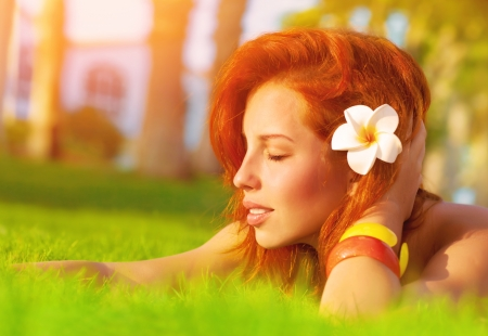 Profile of attractive woman with closed eyes dreaming outdoors photo